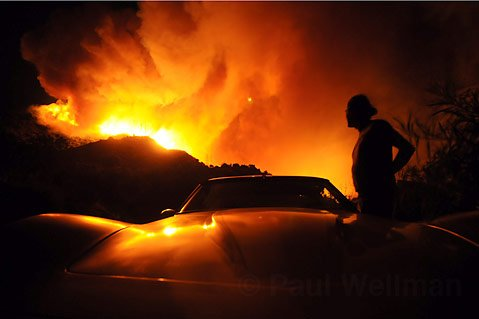 A Mountain Dr. resident pulls over to take one last look at the Tea Fire before evacuating his home