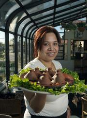 Lily Khamphet serves up a Your Choice Thai Restaurant delicacy, Topless Seafood.