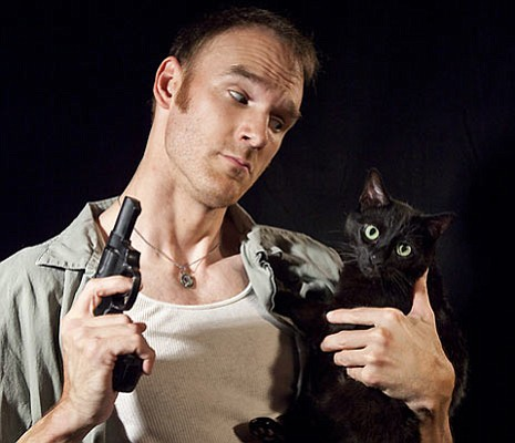 Joe Jordan as Padraic with Charlie the cat as his beloved pet, Wee Thomas. In the actual production, the role of Wee Thomas will be played by a prop.