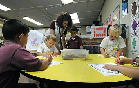 <strong>Teaching two ways:</strong>  Students at Cesar Ch¡vez Charter School learn in both English and Spanish, regardless of their native tongue. Despite growing enrollment numbers and strong community support, the unique K-6 elementary school may be shut down due to below-average standardized-test results. Above, kindergarten teacher Marie-Christine Kannoglou teaches a lesson to her class, the first in the school's nine-year history to have an ideal balance of native English speakers and native Spanish speakers.