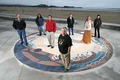 "<strong>THE STORY WEAVERS:</strong>  Though many people put in time to make the Syuxtun Story Circle come to life, the project was led by (from left) Ray Ward, Stephen Franco Jr., Michael Cordero, Gloria Liggett, Sue Nakao, Carmen Sandoval, and Lori Ann David. The mosaic now sits in front of West Beach, near the old village site of Syuxtun, which means ""where the two trails run,"" and which was the largest Chumash settlement at the time of European contact."