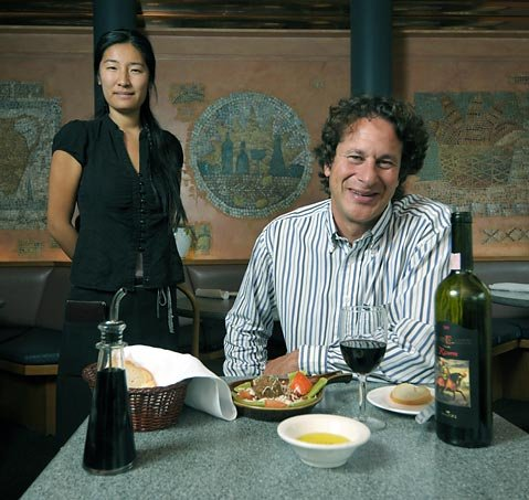 Enjoy the old-school decor and generous portions at Aldo's, owned and managed by Mark Sherman, pictured with server Aya Iwasaki.