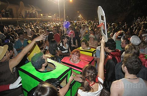 Thousands amassed in costumes flow back and forth along Del Playa Dr., the most popular place to been seen in I.V. on halloween.