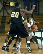 UCSB's Orlando Johnson (holding ball) scored big against Cal State Los Angeles in the Gaucho's November 14 victory.