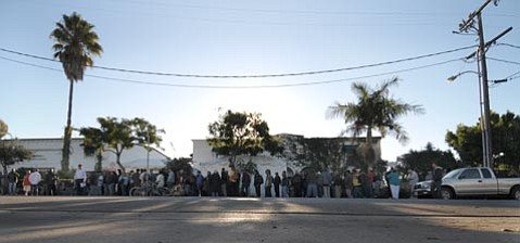 8 a.m. Monday morning the line of people outside the Casa Esperanza Homeless Center stretches down Cacique Street waiting for the services of the 5th annual  Healthy Neighbor program