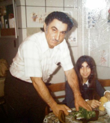 The author's father and her sister sitting down to eat a Thanksgiving meal.