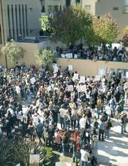 Seen from the third-story meeting room where Regents voted on tuition hikes, students and workers gather in protest at UCLA's Covel Commons.