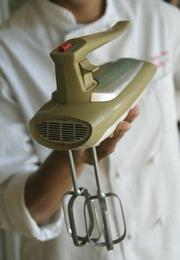 The avocado green mixer that Randall Cook used to make her first cake at age 7