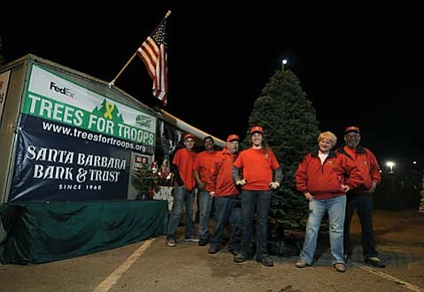 "The group from Anthony's Christmas Trees, located at Earl Warren Showgrounds, is participating in the Trees for Troops program providing ""a Noble Fir for a noble cause."""