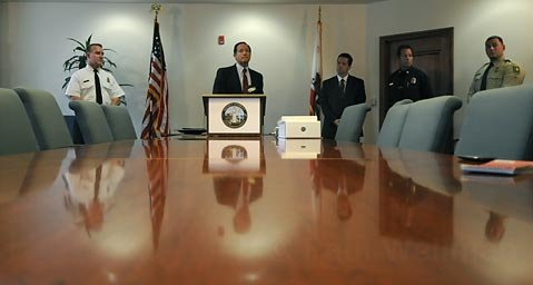 Santa Barbara Senior Deputy District Attorney Jerry Lulejian (center) holds a press conference relating to the two arrests made in the Jesusita Fire. Also in attendance County Fire Chief Michael Dyer, County Fire PIO Capt. David Sadecki, and Acting District Attorney Joshua E. Lynn.