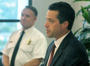 Acting District Attorney Joshua E. Lynn opens the Jesusita Fire press conference with County Fire Chief Michael Dyer.