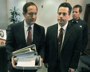 L to R Santa Barbara Senior Deputy District Attorney Jerry Lulejian (left) leaves the Jesusita Fire press conference with a bundle of paperwork related to the case, with former Acting District Attorney Joshua E. Lynn and County Fire PIO Capt. David Sadecki
