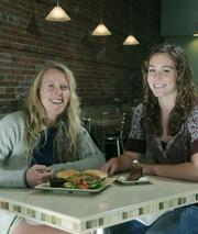 San Luis Obispo's Kendall Perrine (left) and Christa Darr take a break from shopping to enjoy a meal at downtown's California Crisp Cafe.