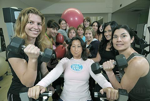 Women's Athletic Club owner Alice Huang (center) has a strong folllowing