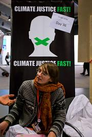 This young lady is from the Climate Justice Action crew. She, as the sign says, hasn&#39;t eaten for more than a month. Some of her cohorts are helping organize a &quot;flood&quot; of the Copenhagen streets tomorrow.