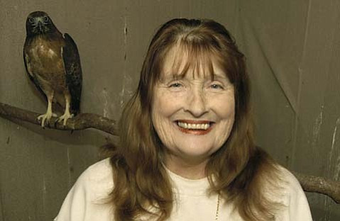 Estelle Busch with an injured red tail hawk under her care in Nov. 2003