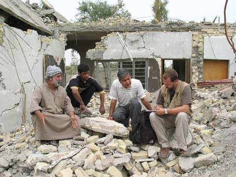 "<strong>Sorting out the rubble:</strong>  Peter Bouckaert is often the first human rights investigator on the ground in any given conflict situation, and, as depicted here, he was quickly on the scene in Iraq following the American invasion in 2003. ""Human Rights Watch has the unique ability to be first on the scene when brutal conflicts happen because we have a very flexible bureaucracy that allows us to mobilize quickly,"" he explained."