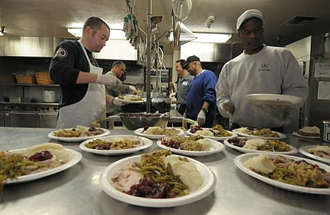 Turkey dinners, plated to order, and served to seated guests by volunteers