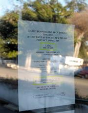 The sign on CARE's door offering directions to the nearest pet hospital in Ventura