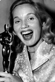 Eva Maria Saint and the Oscar she won for <em>On the Waterfront</em>