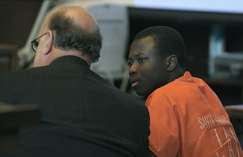 Defense attorney Robert Sanger (left) and Eric Frimpong in court February 2008