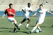 UCSB's Eric Frimpong (center) in a 2005 NCAA match against  SDSU