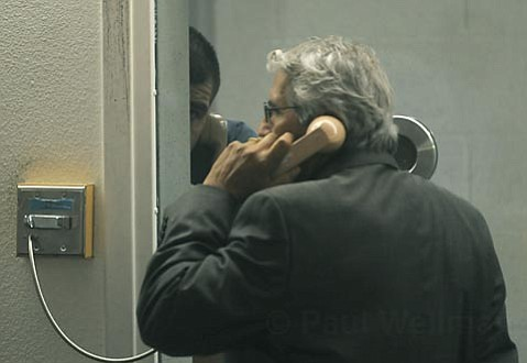 Sergio Quintana stays out of view during his arraignment while speaking with his attorney Joseph Martinez Dec. 31, 2009
