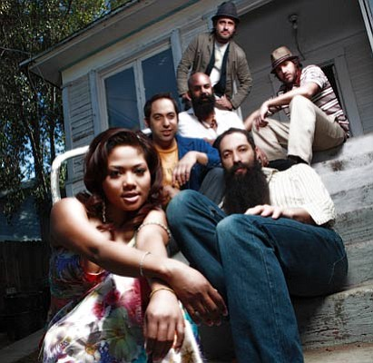 Dengue Fever's Cambodian chanteuse Chhom Nimol (left forefront) takes center stage at SOhO this Thursday night.