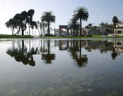 The sun comes out to reveal a flooded Cabrillo Ball Field