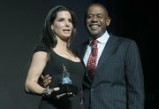 Sandra Bullock with Forest Whitaker, who presented the Riviera award
