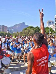 The Diretoria Carnival leads his Bateristas in a Samba drum show with Cristo Redentor towering in the background.