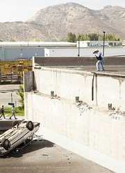 Photographer taking pictures at collapsed bridge in northern Santiago.