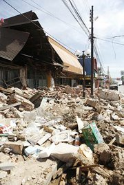 Most buildings in downtown Talca are heavily damaged or destroyed.