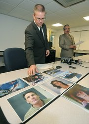 Sgt. Ed Olsen displays mugshot of alleged Gillespie St. shooter Jack Mills and his wife, an alleged accomplice, Rebecca Mills.