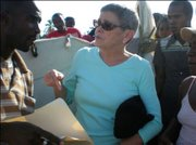 Anne Hastings, CEO of Fonkoze, talks to displaced Haitians about how to access emergency funds through Fonkoze.