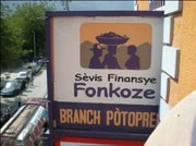 Sign on the newly dedicated Port au Prince branch bank of Fonkoze.  The former bank building was destroyed in the earthquake.