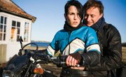 Mikael (Michael Nyqvist) and Lisbeth (Noomi Rapace) trace a long-missing girl in Swedish thriller <em>The Girl with the Dragon Tattoo</em>.