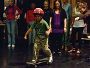 The youngest member of the cast shows off his skateboarding talent.