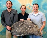 From left, UCSB's Christopher Farwell, Sarah Bagby, and David Valentine with asphalt recovered from underwater volcanoes during a dive on the research submarine Alvin.