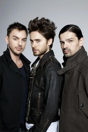 Thirty Seconds to Mars is (from left to right) Shannon Leto, Jared Leto, and Tomislav  Miličević.