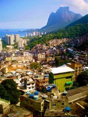 From the rooftop of a home in Rocinha, the community sprawls out in front, giving way to São Conrado in the flat area to the west, and the biggest seaside monolith in the world, Pedra de Gávea, in the background.
