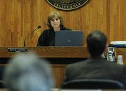 Judge Jean M. Dandona listens to arguments from prosecutor Brian Cota June 8, 2010