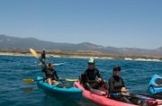 Paddlers gather off the Gaviota Coast on Saturday to raise awareness about the Naples Reef.