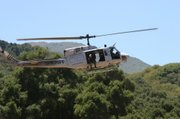 Helicopters, like the one seen here, were used to drop personnel into the field and haul out bundles of mature marijuana plants