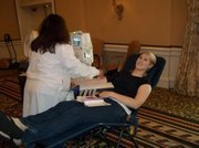 A volunteer donates blood at the Biltmore's outreach event
