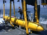 MBARI's mapping AUV is prepared for launch from the research vessel Zephyr by Senior Research Specialist Dave Caress.