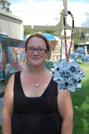 Artist Kimberly Joy Quinn and her artwork.
