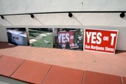 "Photos taken at Mari Mender's vandalized property, and an intact ""Yes on T"" sign"