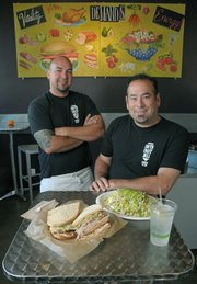 South Coast Deli co-owner Jim St. John (seated) and manager Josh Escalante.