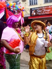 Some drag queens enjoy the early festivities of the Parada Gay da Rocinha Sunday, November 25.